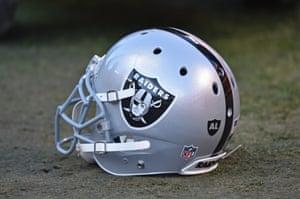 A Raiders helmet lies on the field