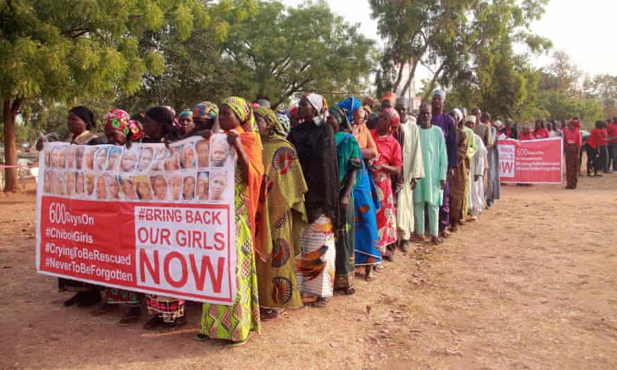 Members of the Bring Back Our Girls movement and mothers of the missing schoolgirls march in Abuja.
