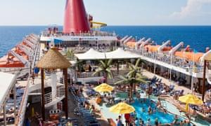 Cruise passengers enjoying the sun on deck.