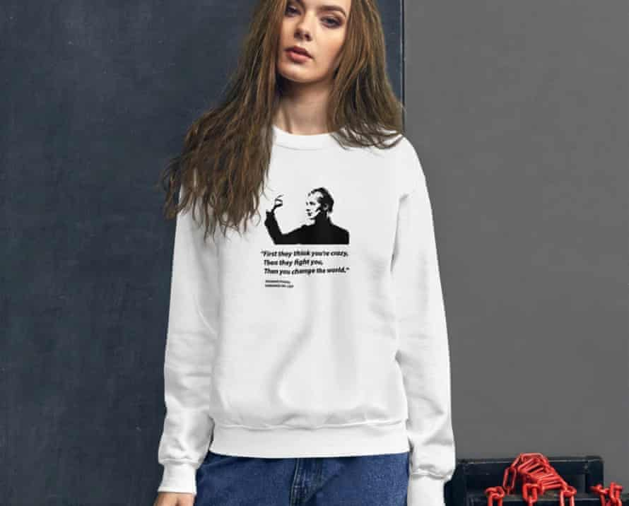 """A sweatshirt features one of Holmes' favorite quotes: """"First they think you're crazy, then they fight you, then you change the world."""""""