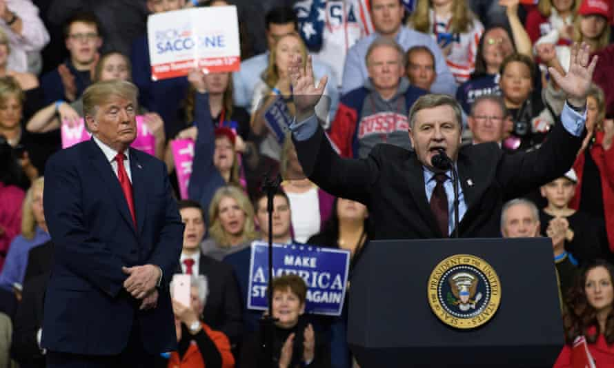 Donald Trump with Rick Saccone in Moon Township on Saturday night.