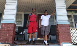 Shacory Blanks passes the day on her mother's porch with her friend Sherrel Porter.