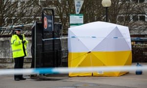 A police officer stands guard by a forensics tent in Salisbury
