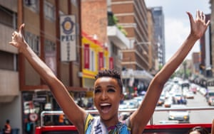 Johannesburg, South Africa. Zozibini Tunzi waves as she is driven through the streets during her homecoming parade after wbeiung crowned Miss Universe.