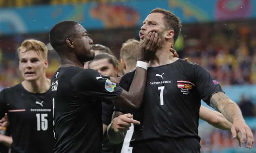 David Alaba intervenes as Marko Arnautovic celebrates his goal against North Macedonia.