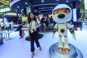 A woman walks past an entertainment robot by Chinese tech firm Sogou at a technology conference in Shanghai, China