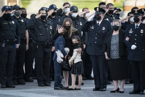 Logan and Abigail Evans, children of the late US Capitol police officer William 'Billy' Evans, stand with their mother as Evan's flag-draped casket is carried from the Capitol