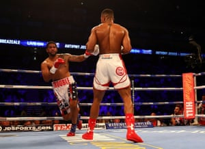 Dominic Breazeale stumbles after taking a shot from Anthony Joshua.