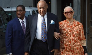 Bill Cosby arrives, along with his wife Camille Cosby and spokesman Andew Wyatt, for closing arguments in his retrial on sexual assault charges on Tuesday.
