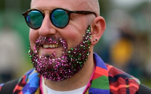 A reveller arrives beard-glitter ready