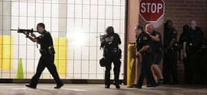 Dallas police respond after shots were fired during a protest over recent fatal shootings by police in Louisiana and Minnesota, Thursday, July 7, 2016, in Dallas. Snipers opened fire on police officers during protests; several officers were killed, police said. (Maria R. Olivas/The Dallas Morning News via AP)