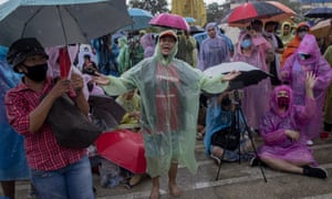 Pro-democracy students and their supporters dance to rap music during a protest rally in Bangkok on Sunday