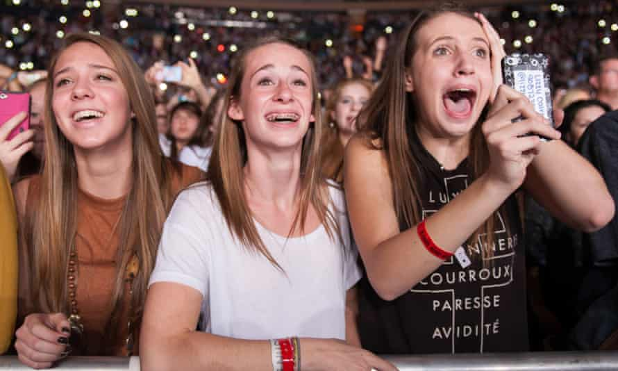 Fans of One Direction scream as the group performs at Madison Square Garden.