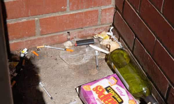 Syringes and other drug paraphernalia lie in an alley in North Richmond.