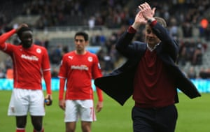 Ole Gunnar Solskjær applauds Cardiff's fans after relegation from the Premier League in 2014.