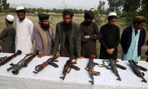 Militants surrender their weapons as part of a reconciliation initiative in Afghanistan