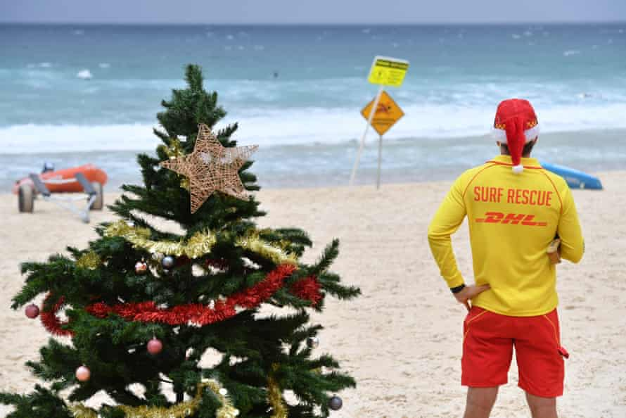 A surf lifesaver is seen on a windy and rainy Christmas Day on Bondi Beach on Friday.