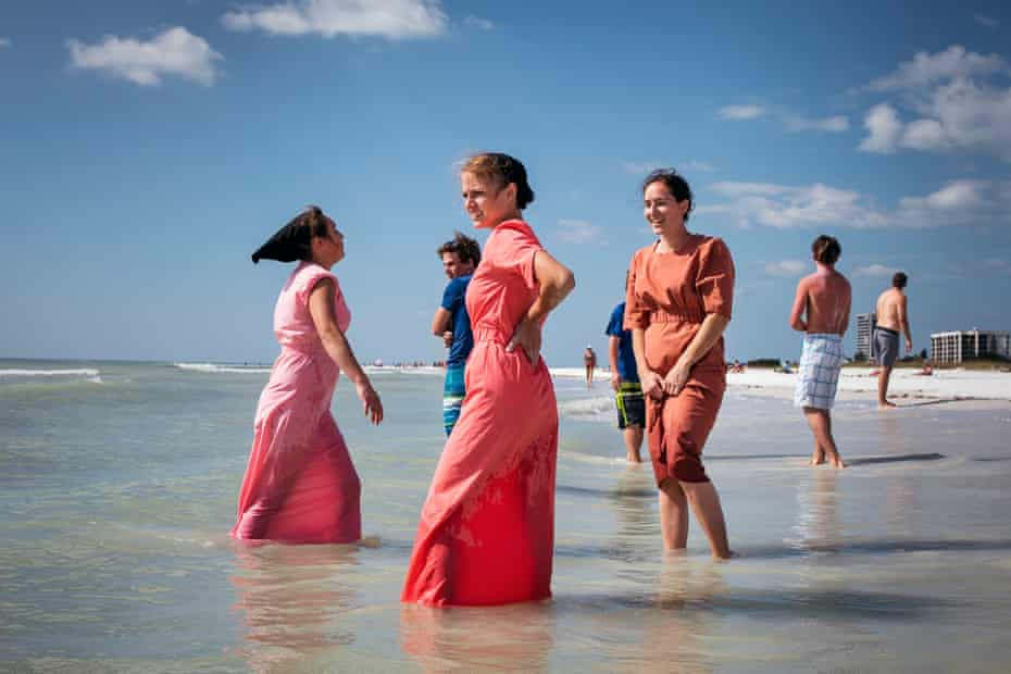 Exchanging glances with boys … young Amish girls from Kentucky stand at the beach, a popular destination with Amish and Mennonite people.