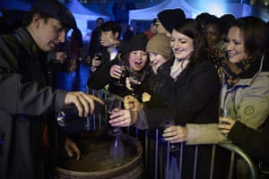 People celebrate the launch of the year's Beaujolais nouveau red wines in Lyon, France