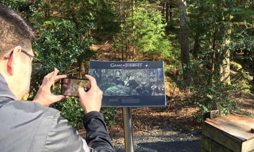 A tourist on the Game of Thrones trail in Tollymore forest in Northern Ireland.