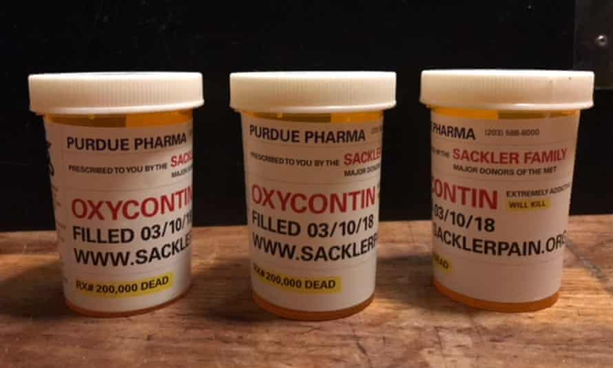 Mock OxyContin bottles, which say 'Rx 200,000 dead' at the bottom of the label.