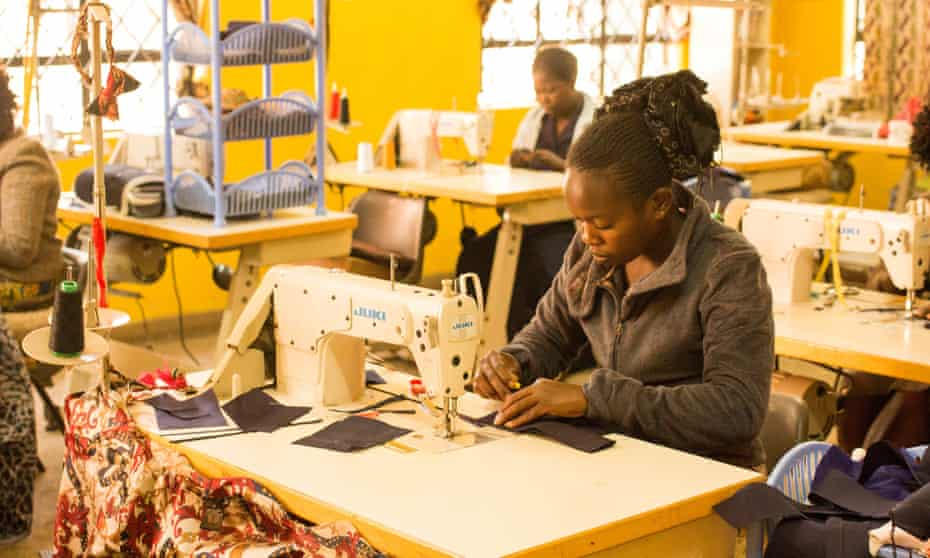 Catherine Makie, 27, sews bow ties for European and US markets in Nairobi's Kibera slum. Photo: Anna Dubuis