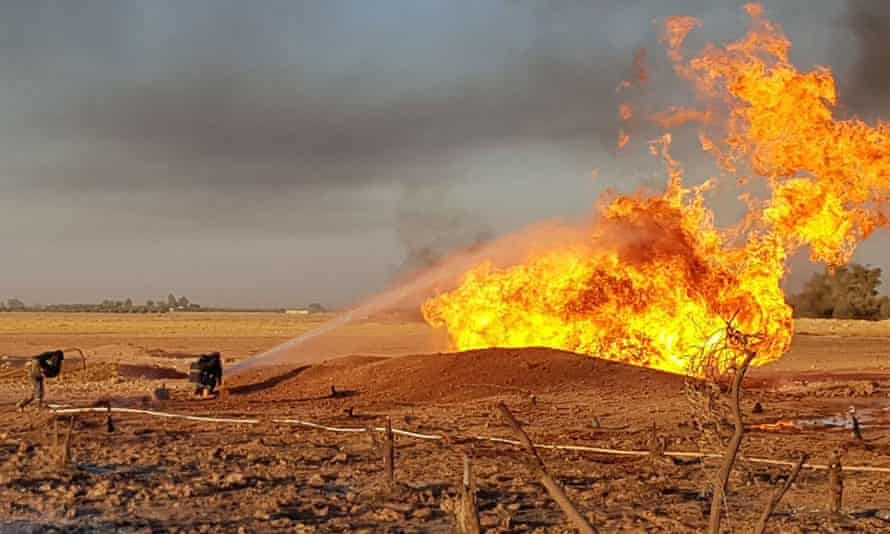 Syrian firefighters extinguish the flames of a gas pipeline that was hit by an explosion.