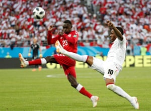 Peru's Jefferson Farfan challenges Denmark's Pione Sisto for the ball at the Mordovia Arena. Denamark won the match 1-0, thanks to Yussuf Poulsen.