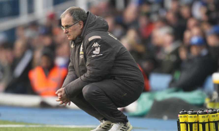 Marcelo Bielsa crouches during Leeds' dramatic win at Birmingham.
