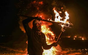 Palestinians burn torches and tyres during the Great March of Return demonstration in Shuja'iyya, Gaza City, Gaza