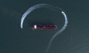 In this 21 July photo, an aerial view shows a speedboat of Iran's Revolutionary Guard moving around the British-flagged oil tanker Stena Impero. Iran has stepped up harassment of oil shipping.