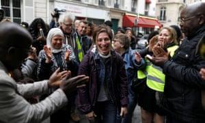 Leilani Farha, centre, visits homeless families in Paris