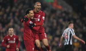 Fabinho celebrates with Virgil van Dijk after scoring Liverpool's fourth goal against Newcastle.