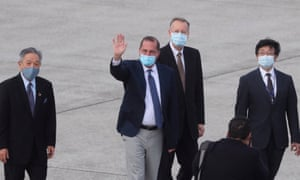 US Health Secretary Alex Azar waves to the journalists as he arrives at Sungshan Airport in Taipei on August 9, 2020.