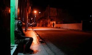 Zoraide Hernandez sits at her doorstep for fresh air in Havana, Cuba, this week.