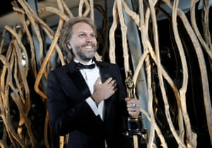 Florian Zeller holds his Oscars statuette, in Paris, after winning best adapted screenplay for the The Father
