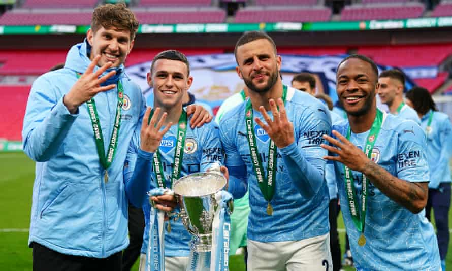 John Stones (far left) celebrates another Carabao Cup win with his Manchester City and England teammates (left to right) Phil Foden, Kyle Walker and Raheem Sterling.