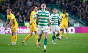 James Forrest celebrates scoring Celtic's third goal against Livingston.