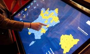 Woman touching screen graphic
