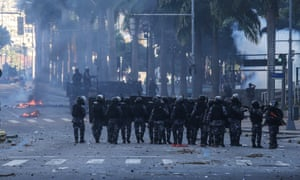 Police face protesters in Rio on 6 December.