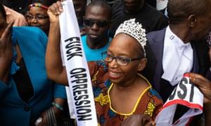 Stella Nyanzi celebrates with supporters outside a court in Kampala following her release
