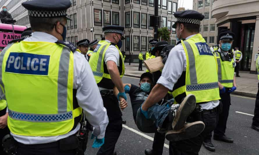 Police arrest an Extinction Rebellion protester
