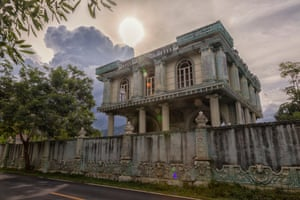The sun begins to set over this rusty beachside mansion in southern Thailand has retained its beauty – despite no one living there for more than 25 years, Prachuap Khiri-Khan, Thailand