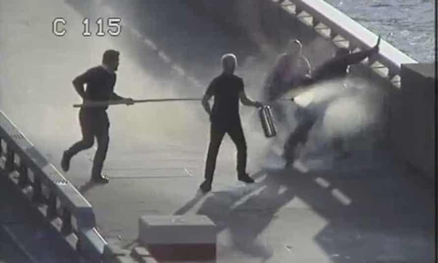 Still from CCTV footage showing Khan being confronted by Darryn Frost, Steve Gallant and John Crilly on London Bridge following the attack.