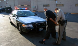 A Las Vegas police officer searches a man. The TV show Cops was one of the first to expose viewers to law enforcement in the field.