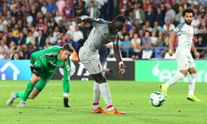 Liverpool's Sadio Mane goes round Crystal Palace goalkeeper Wayne Hennessey to score his side's second goal.