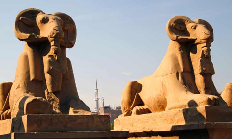 Two of the ram-headed sphinxes at the entrance of the Temple of Karnak in Luxor.