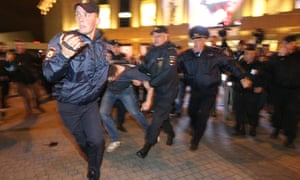 Policemen detain demonstrators in St Petersburg.
