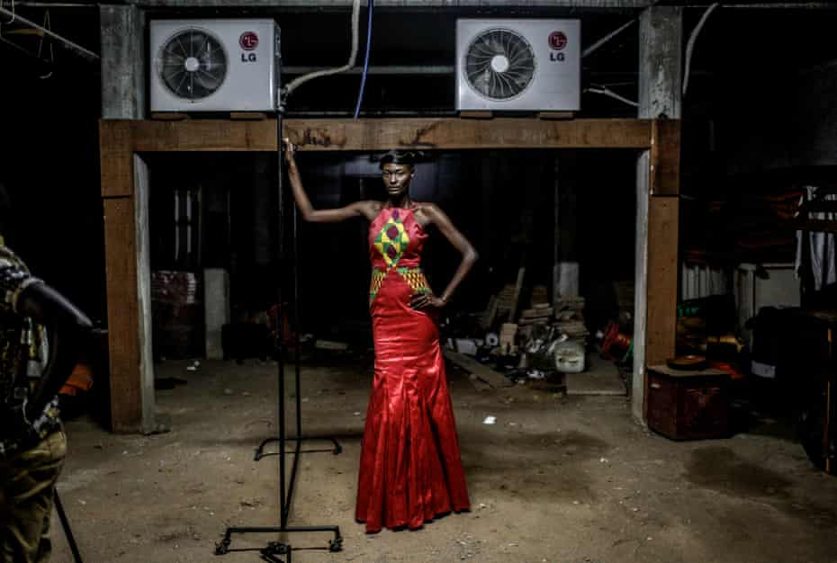 Model Amy Faye waits backstage during Dakar fashion week, June 2016