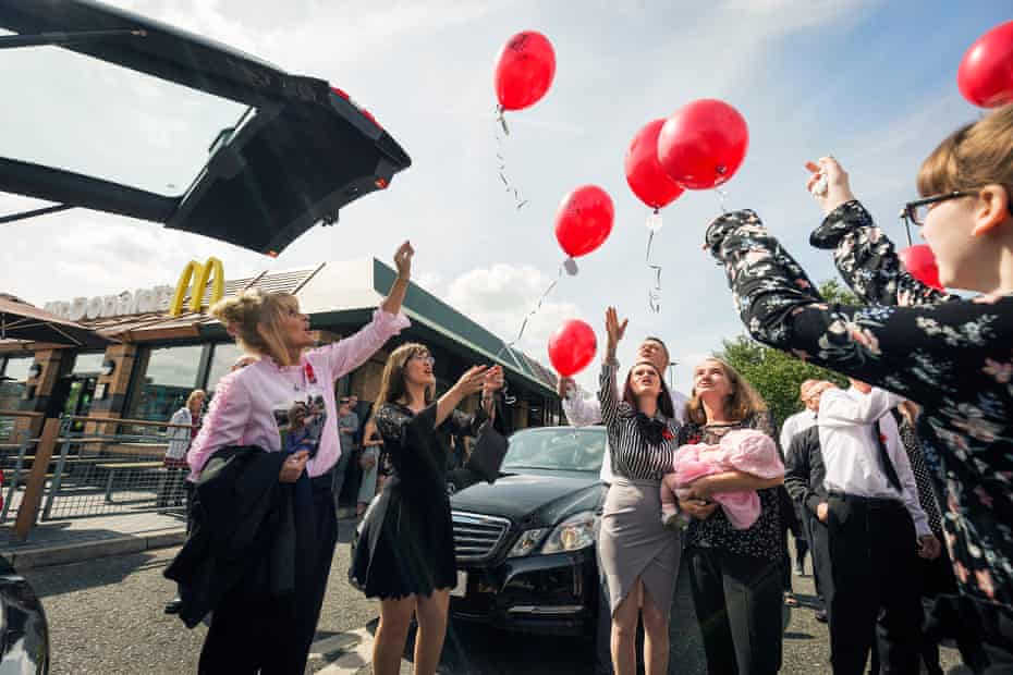 Family and friends of Joshua Connolly-Teale at a McDonald's drive through